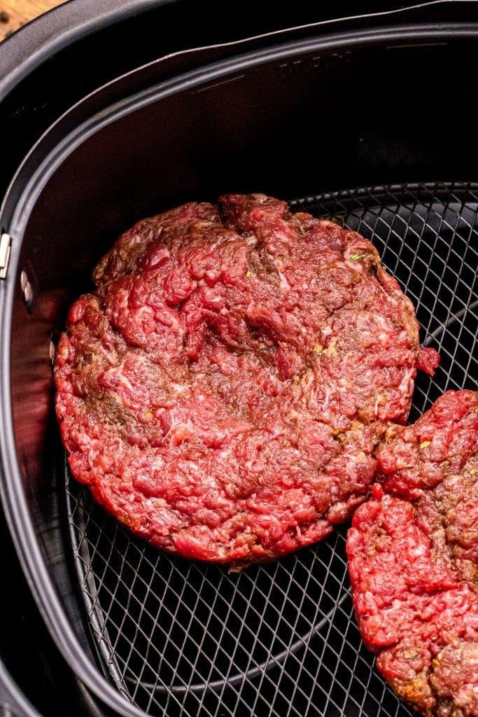 Hamburger patties in air fryer basket