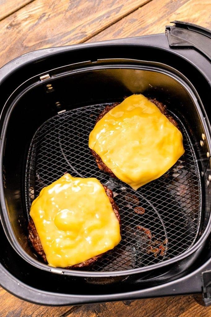 Cheeseburger in air fryer basket