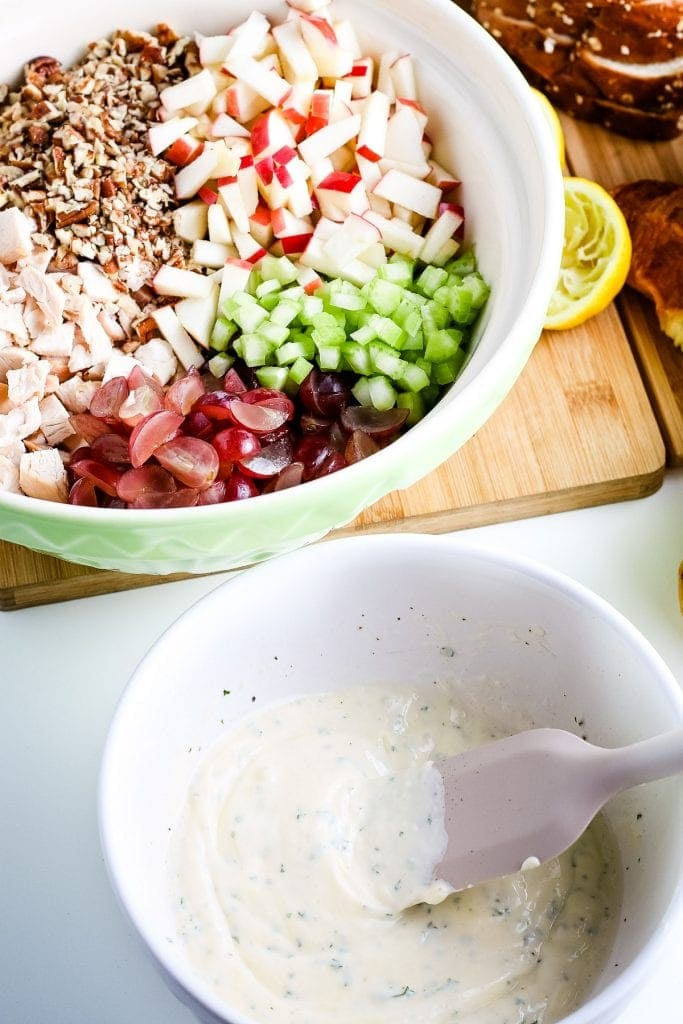 White bowl with dressing for chicken salad after mixing.