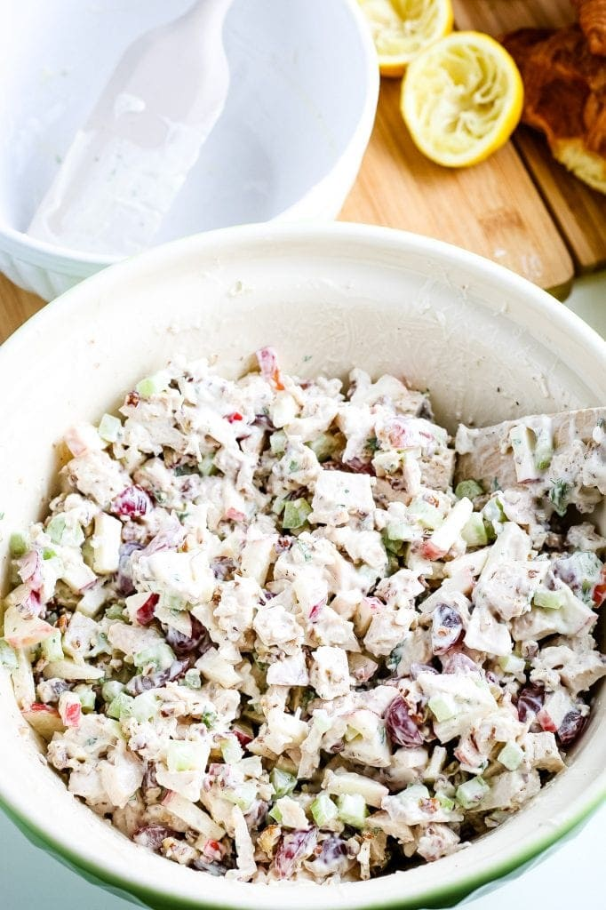 White bowl with filling for chicken salad sandwiches mixed together