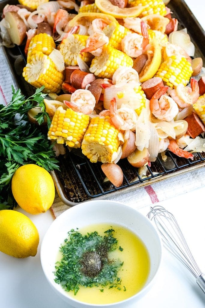White bowl with ingredients for butter sauce before mixing and pouring on shrimp boil.