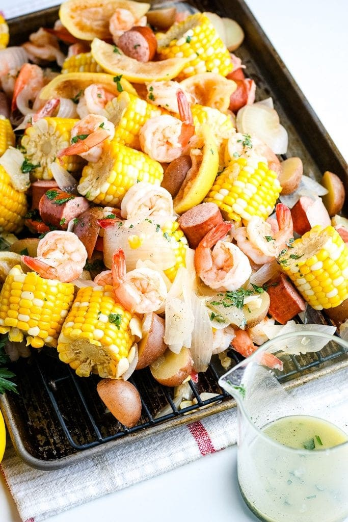 Shrimp Boil cooked and poured out onto a sheet pan.
