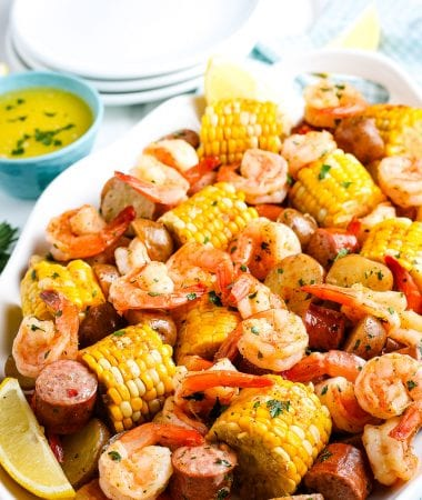 Shrimp Boil on what platter with white plates and napkin in background