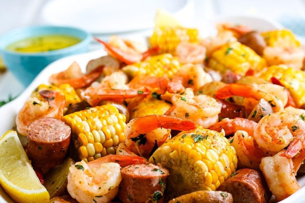 Close up image of finished shrimp boil on white platter