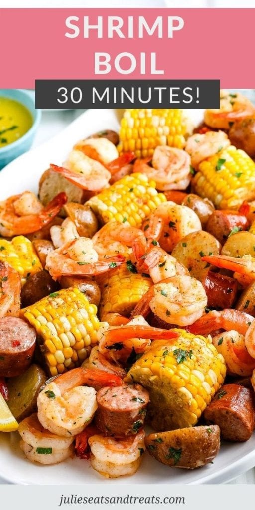 Pin Image for Shrimp Boil with text overlay of recipe name on top and a photo below showing it on a white serving platter.