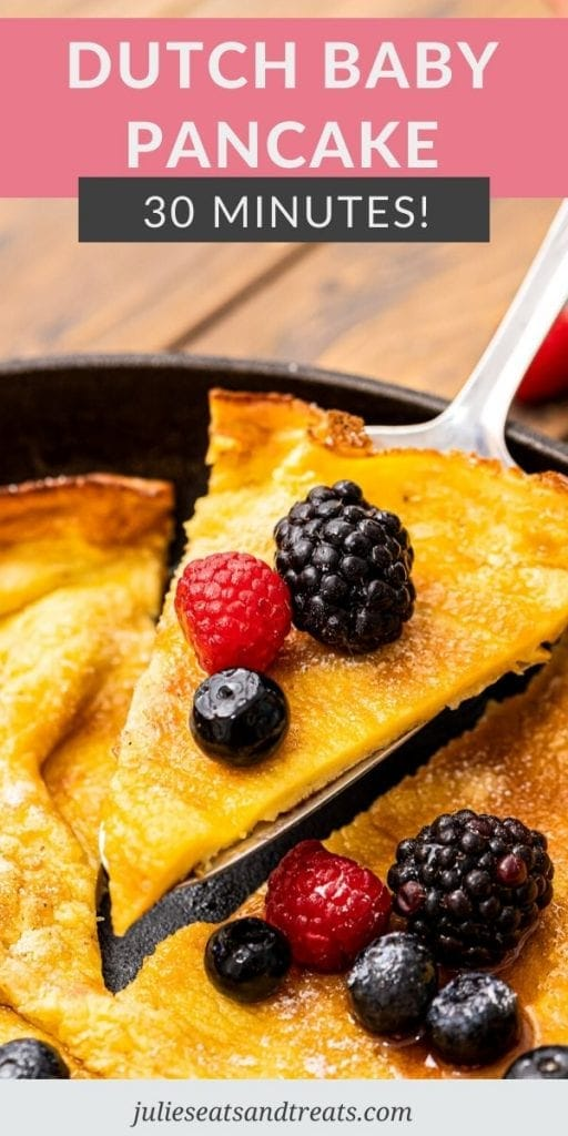 Pinterest Image with text overlay of Dutch Baby Pancake on top and the bottom has a slice of pancake with fresh berries on serving spatula.
