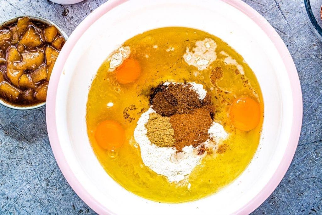 Dulce de Leche Apple Poke Cake wet ingredients in bowl before mixing