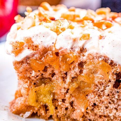 Dulce de Leche Apple Poke Cake sliced and on a plate