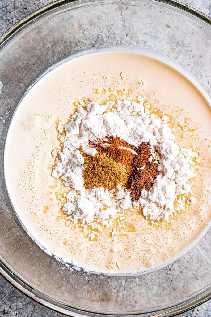 Dulce de Leche Apple Poke Cake whipped cream ingredients in glass bowl