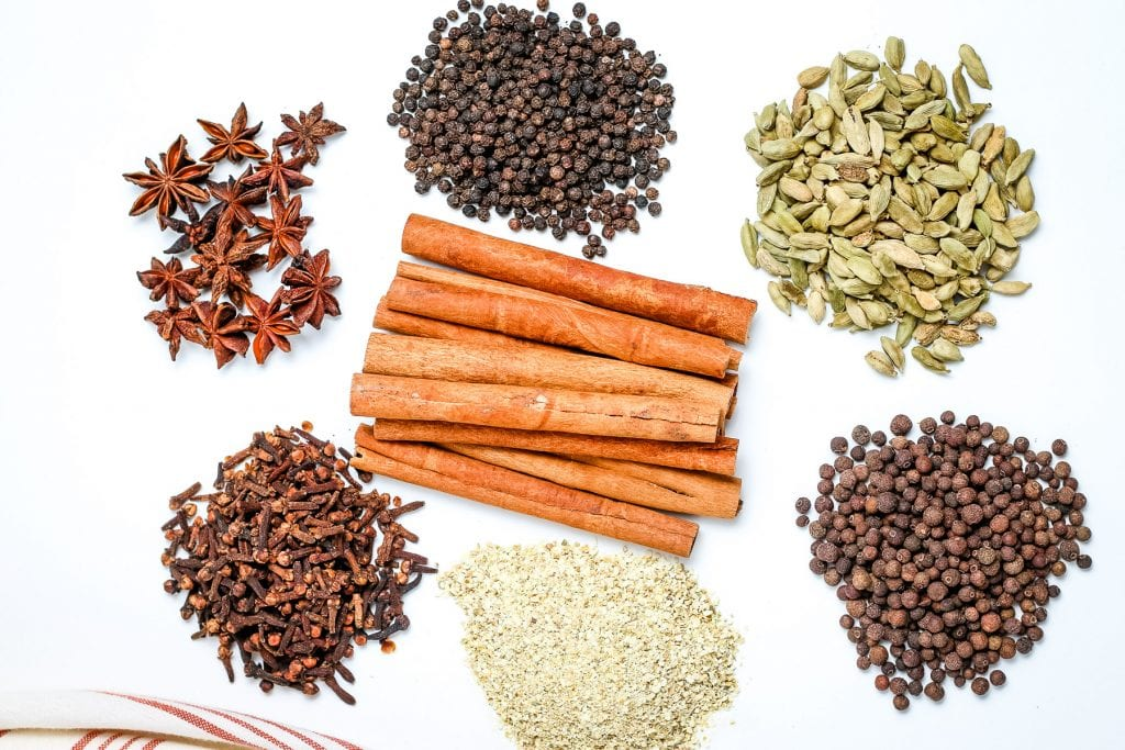 Mulling Spices Ingredients in groups on white background