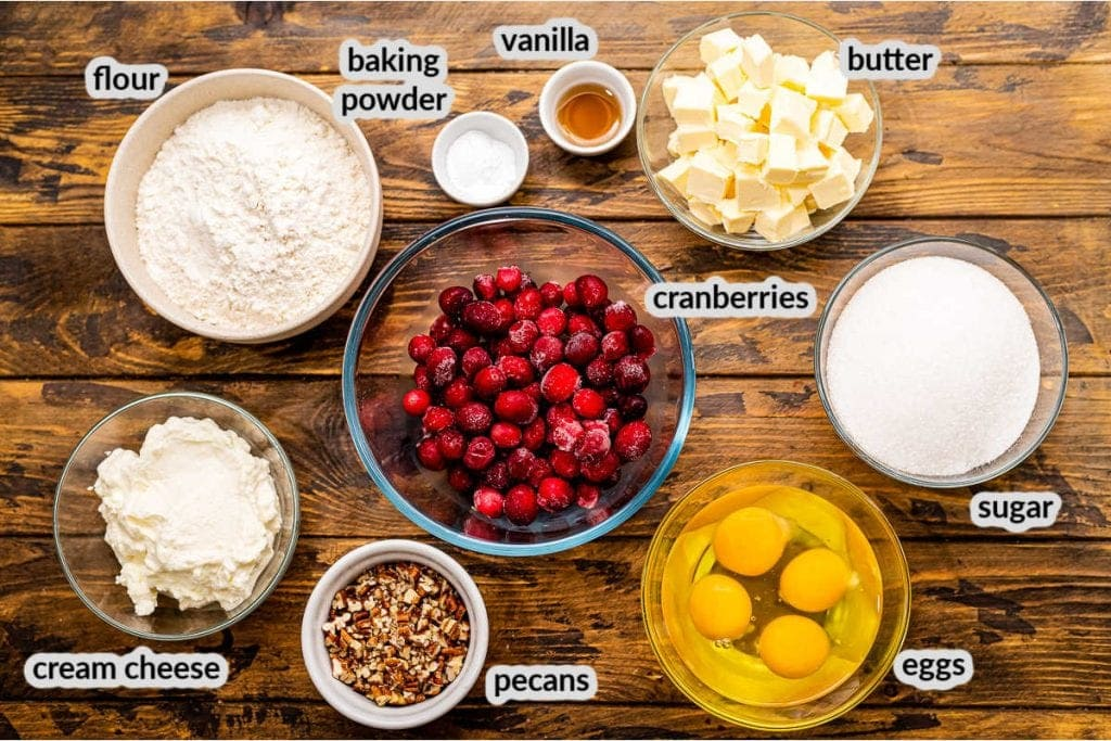 Cranberry Muffins Ingredients in bowls on wooden background