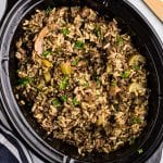 Black Crock Pot with Crock Pot Hamburger Wild Rice Casserole in it.