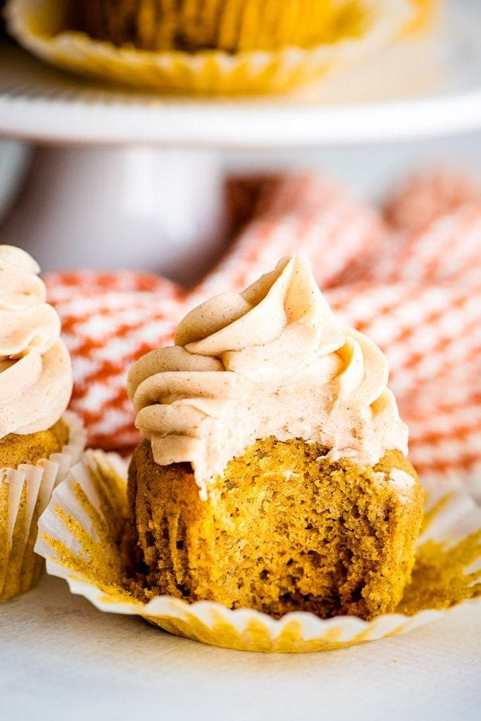 Pumpkin Cupcakes unwrapped and a bite taken out of it