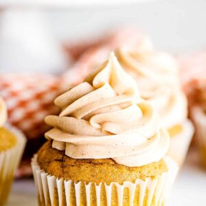Close up image of a frosted pumpkin cupcake