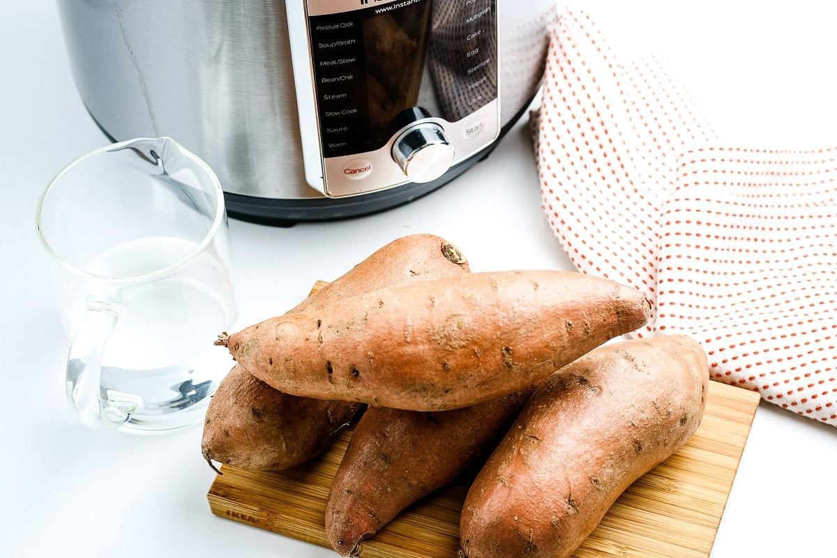 Sweet Potatoes in front of Instant Pot