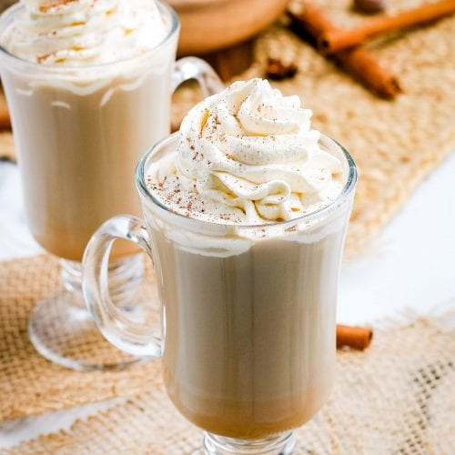 Pumpkin Spice Latte in mugs with whipped cream on top.