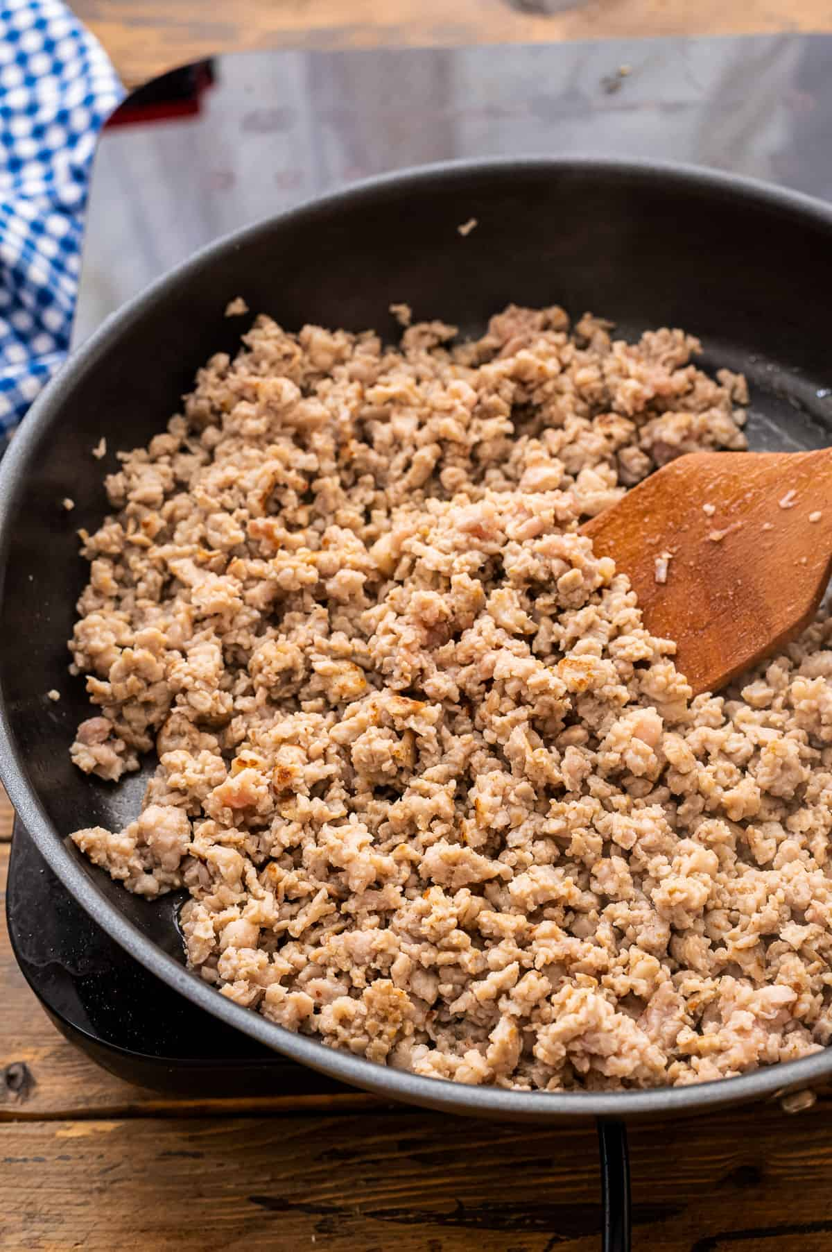 Cast Iron skillet with ground sausage being browned in it