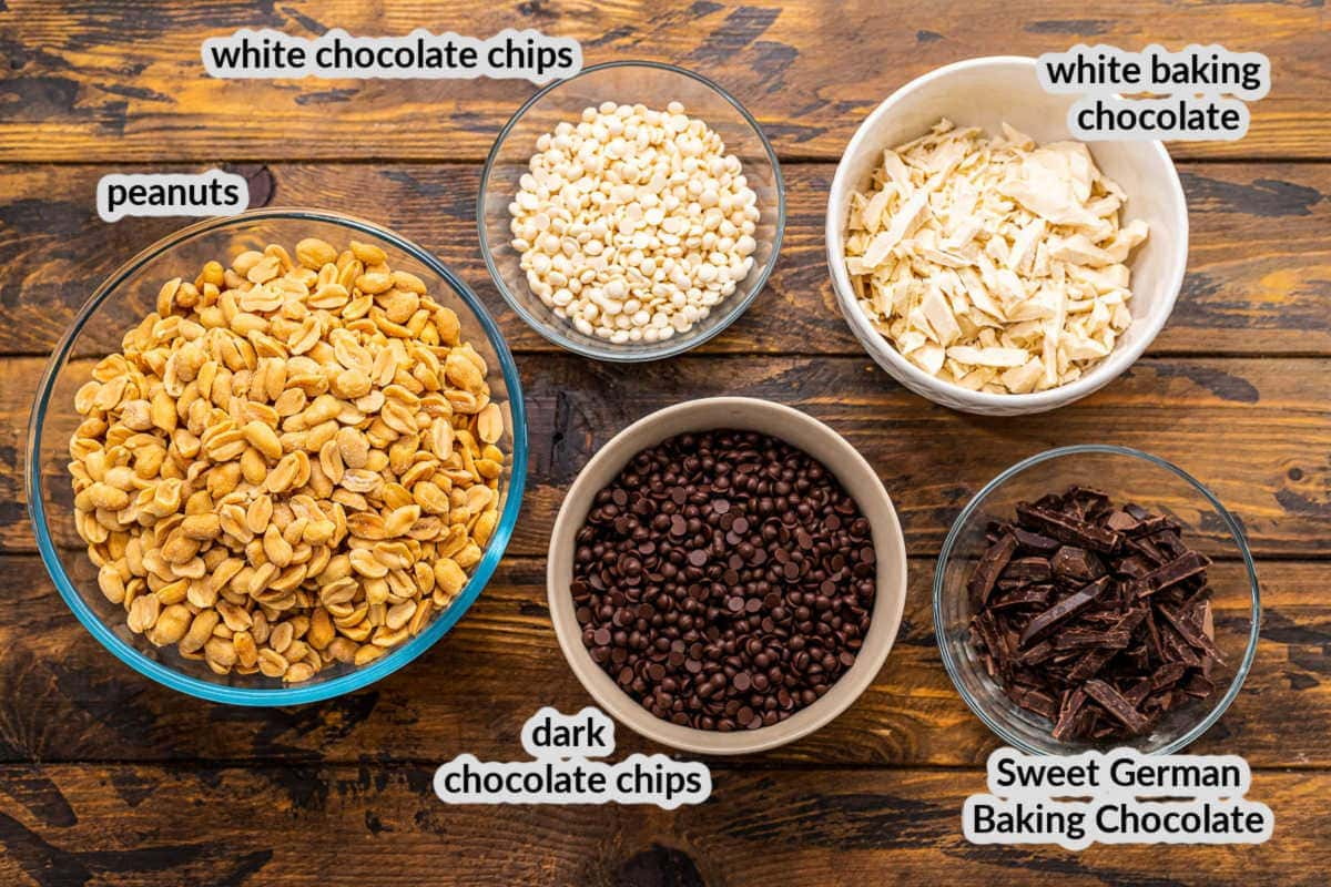 Crock Pot Peanut Clusters Ingredients in bowls on wooden background