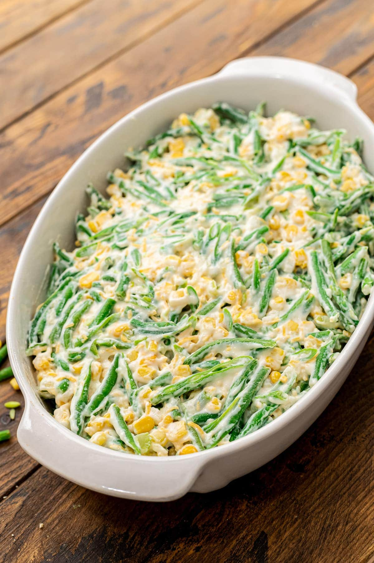 Green Bean Corn Casserole in white baking dish before baking