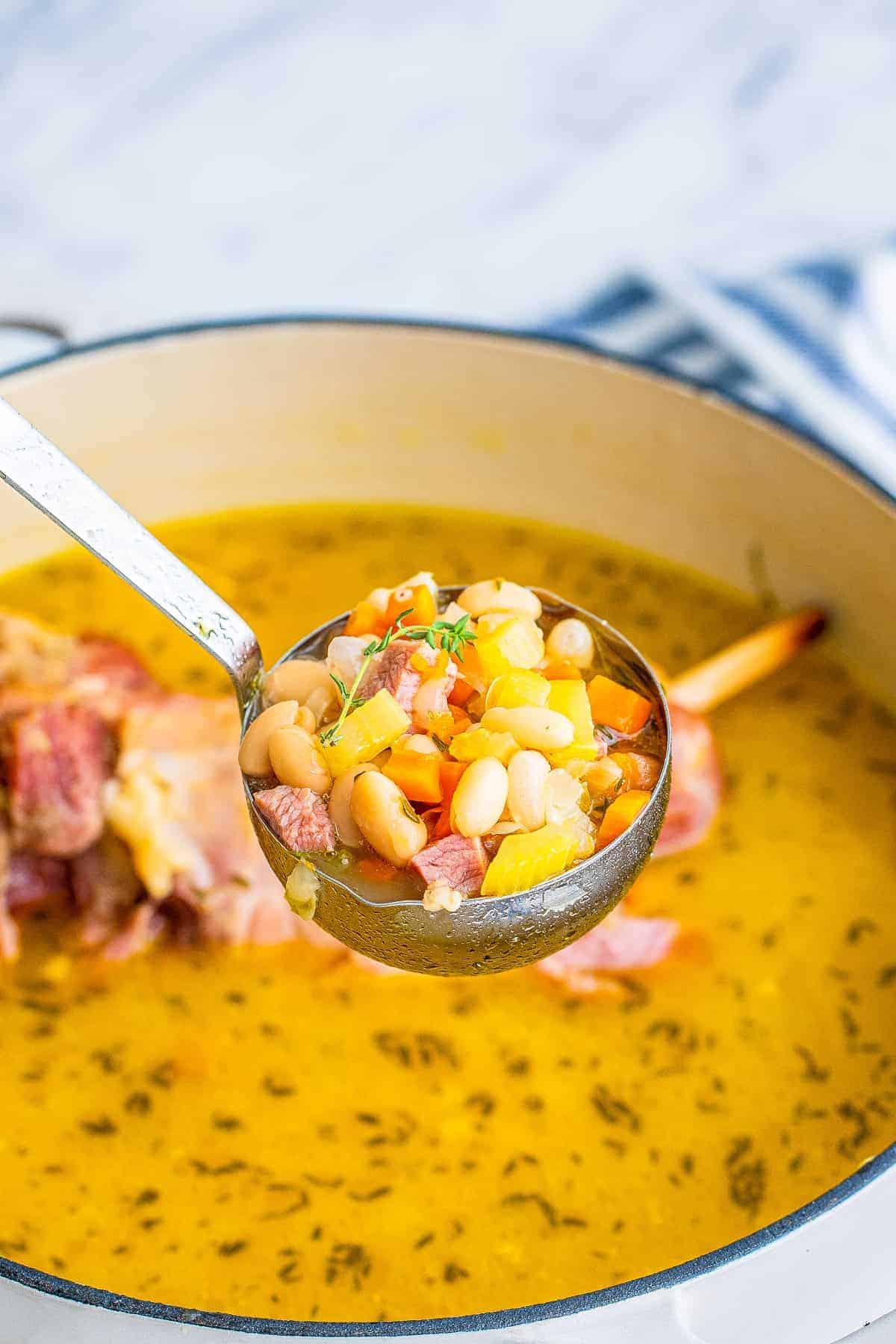 Ladle with ham bone soup in it