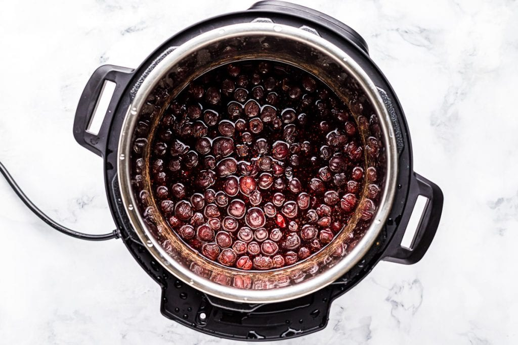 Instant Pot with ingredients in it to make cranberry sauce before cooking.