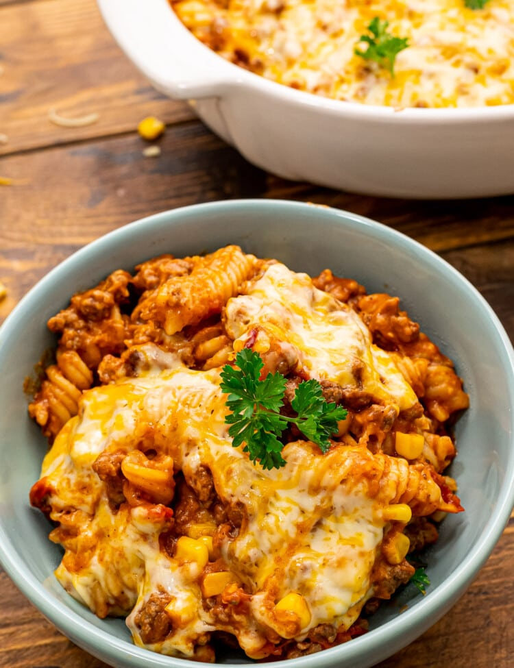 Mexican Pasta Bake in blue bowl topped with parsley