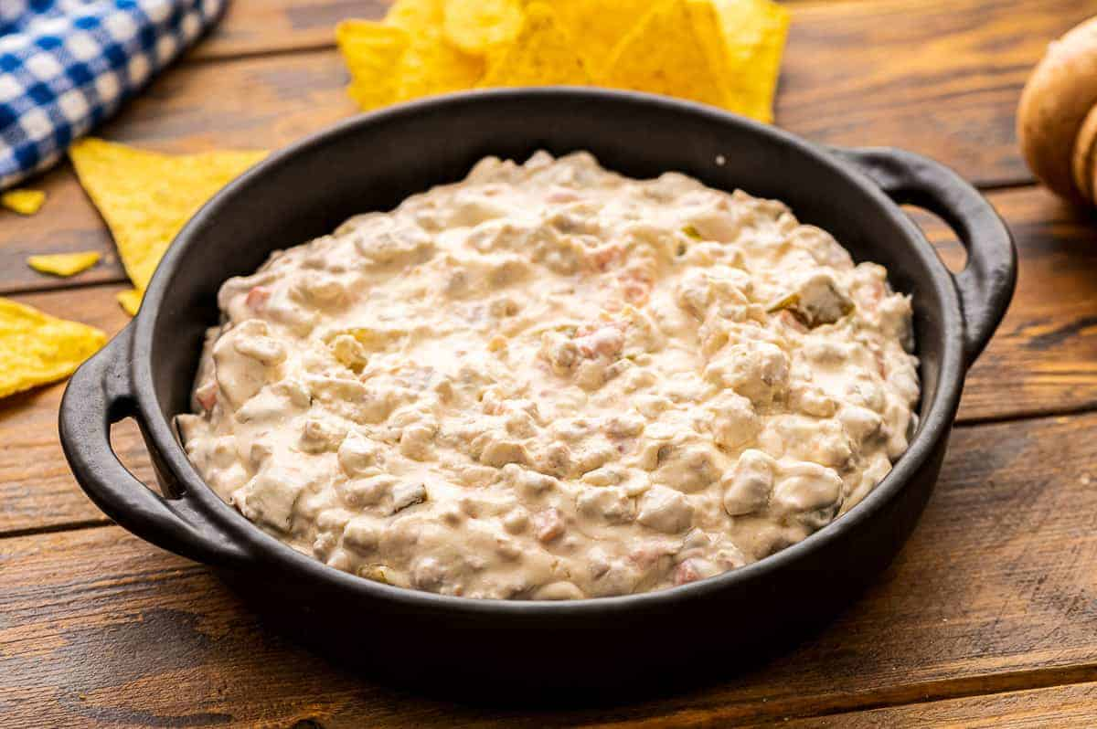 Cast iron skillet with cream cheese sausage dip in it