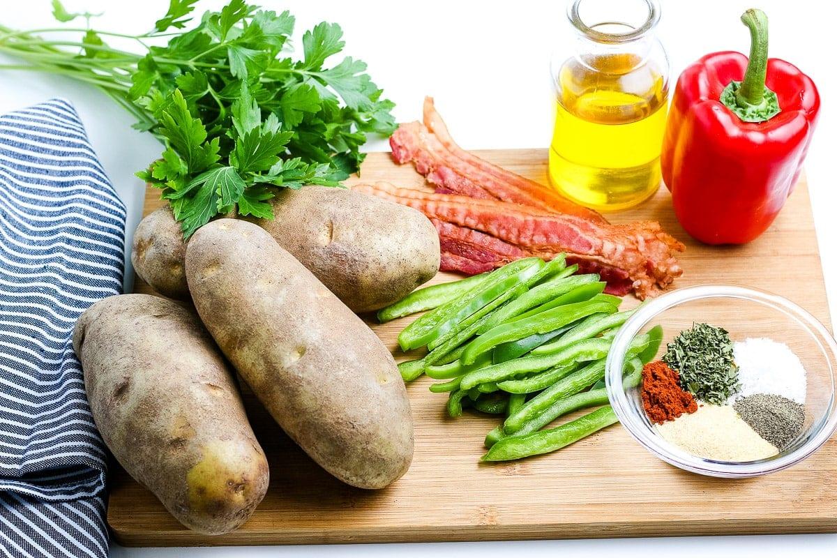 Breakfast Potatoes Ingredients on wooden cutting board