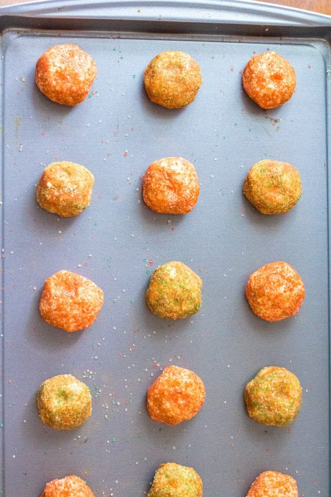 Sheet pan with balls of Christmas Snickerdoodles dough on it