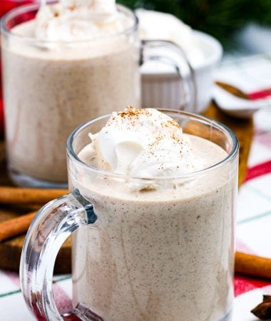 Homemade Eggnog in mugs topped with whipped cream.