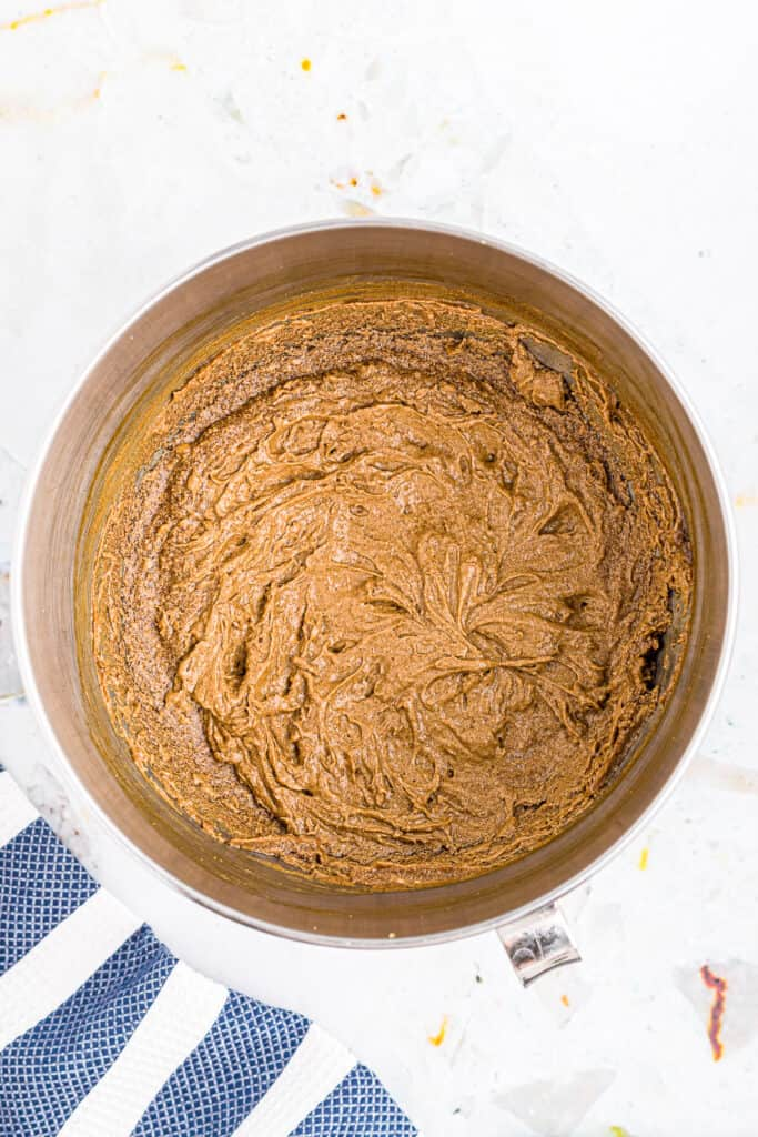 Overhead of image of wet ingredients for molasses cookies after mixing