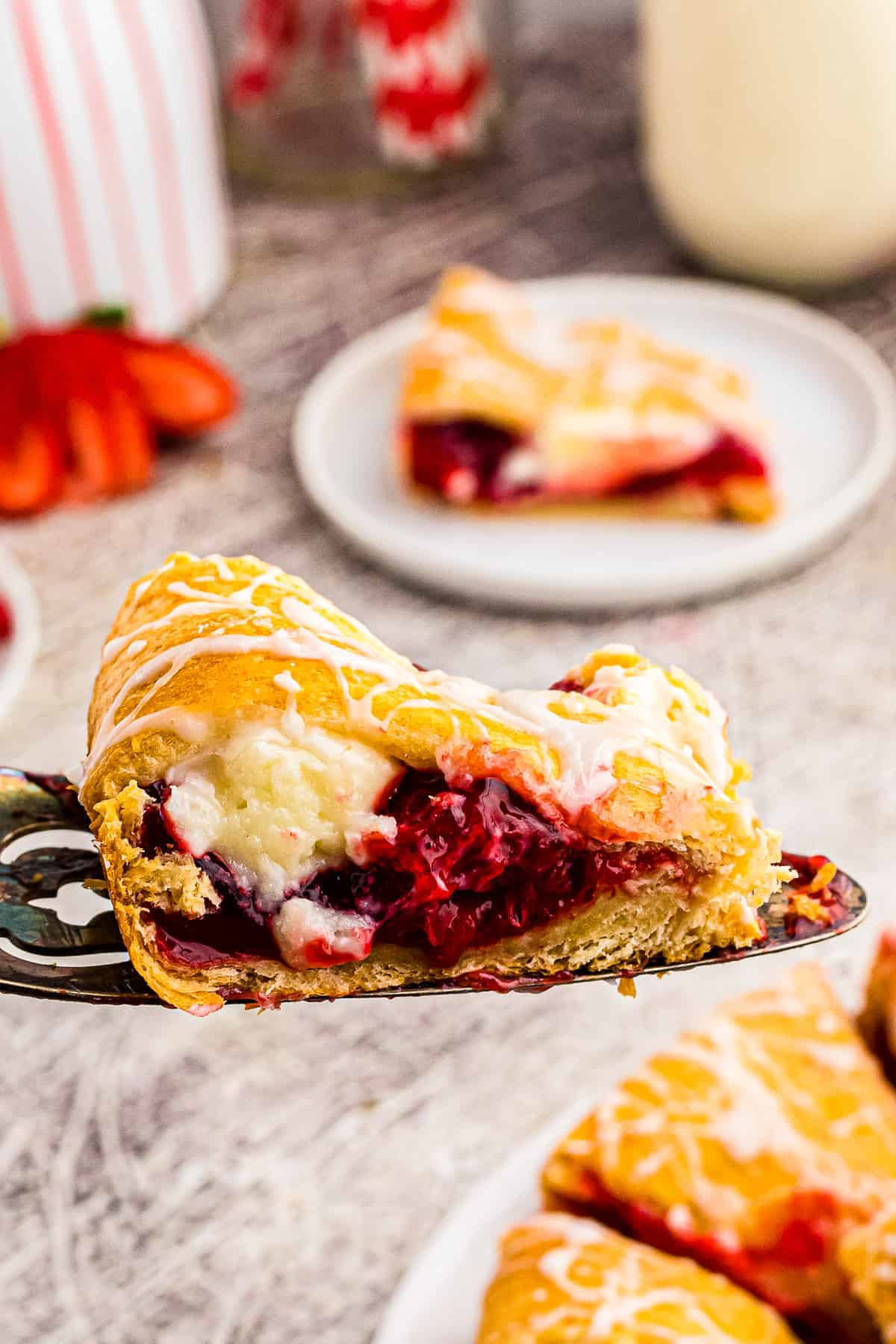 Slice of Strawberry Cheesecake Crescent Ring on spatula