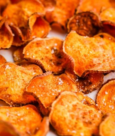 Close up of cooked Air Fryer Sweet Potato Chips seasoned with salt