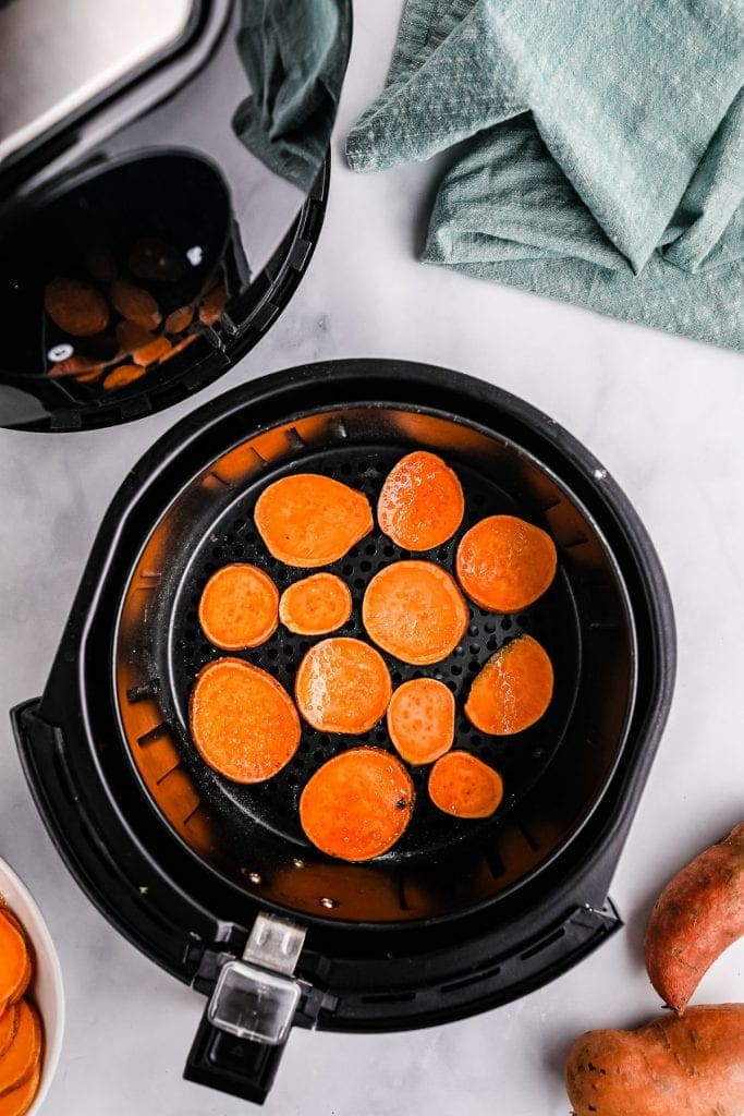 Sweet potatoes in air fryer basket before cooking