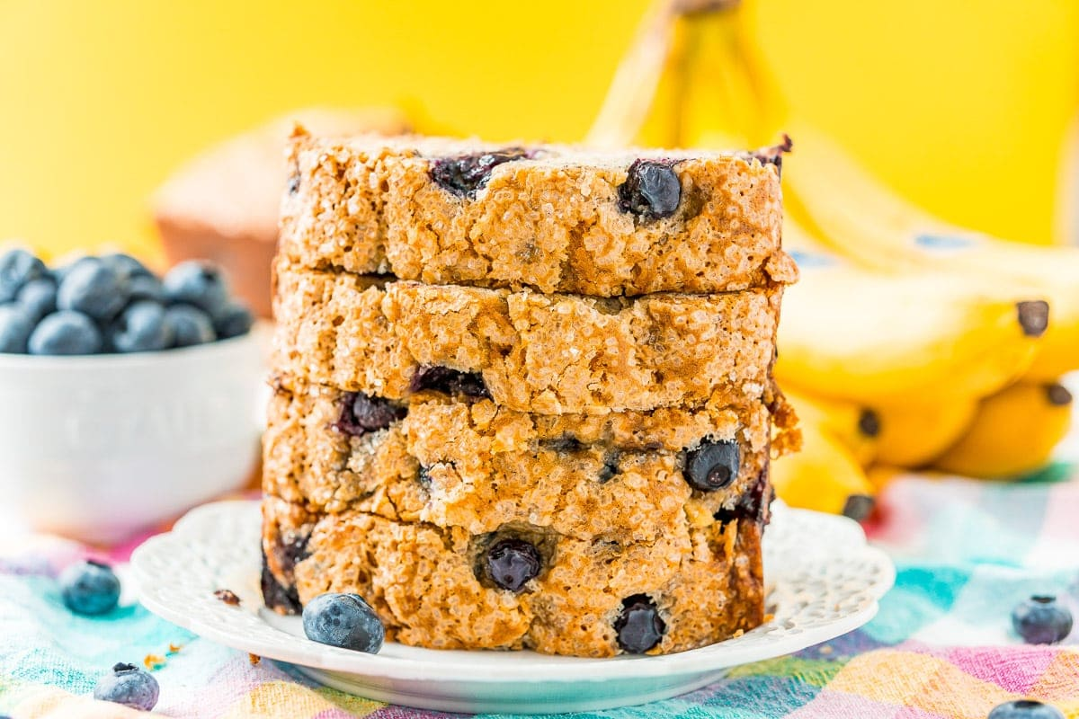 Blueberry Banana Bread sliced and stacked on a plate.