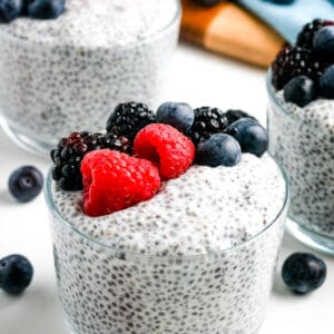 Glass bowl of Chia Pudding topped with berries