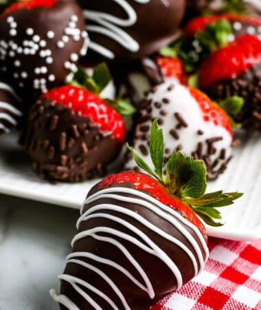Chocolate Covered Strawberry on red and white checkered napkin