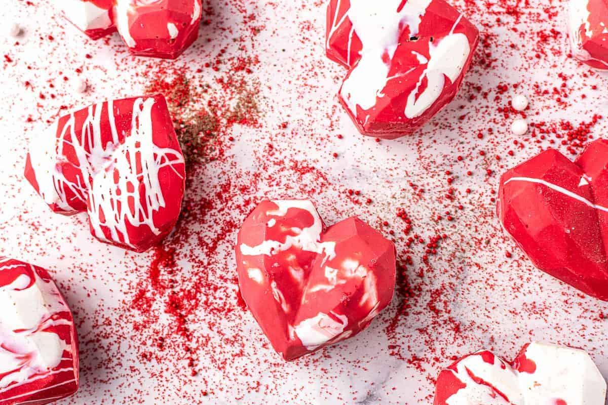 Overhead image of red heart shaped hot chocolate bombs