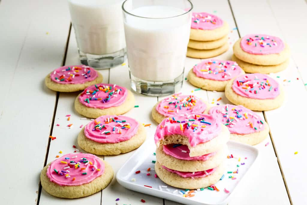 Pink Frosted Lofthouse Cookies in a stack with pink frosting