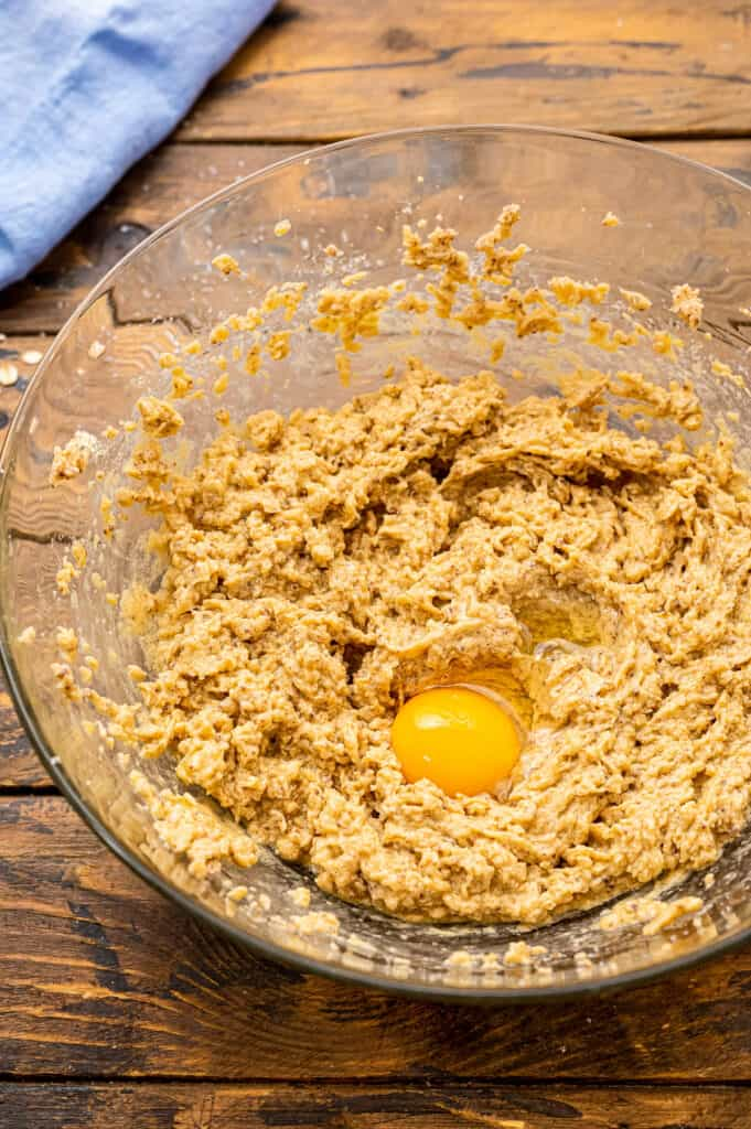 Oatmeal cookie dough with egg in middle not mixed in