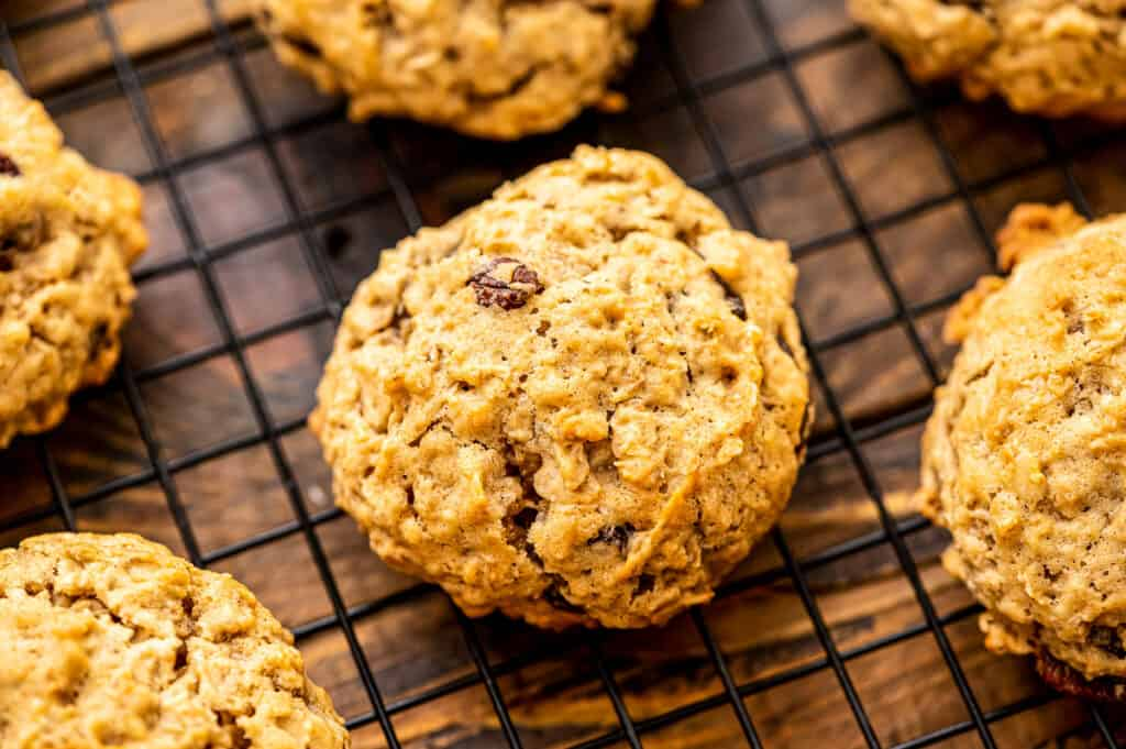 Baked oatmeal raisin cookies on wire cooling rack