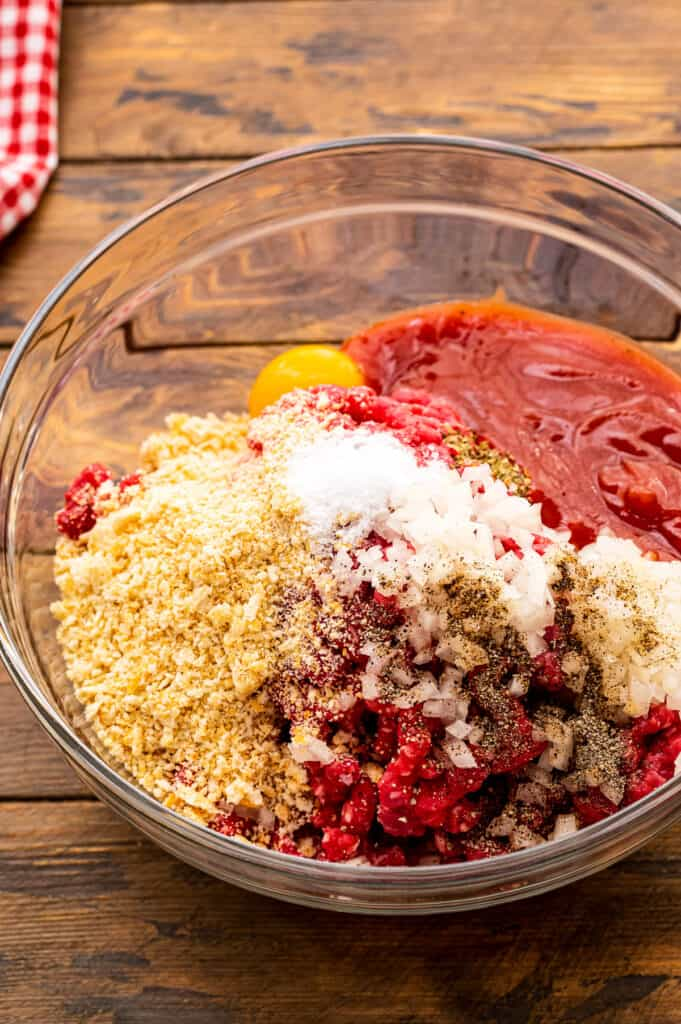 Glass bowl of ingredients for Italian meatloaf