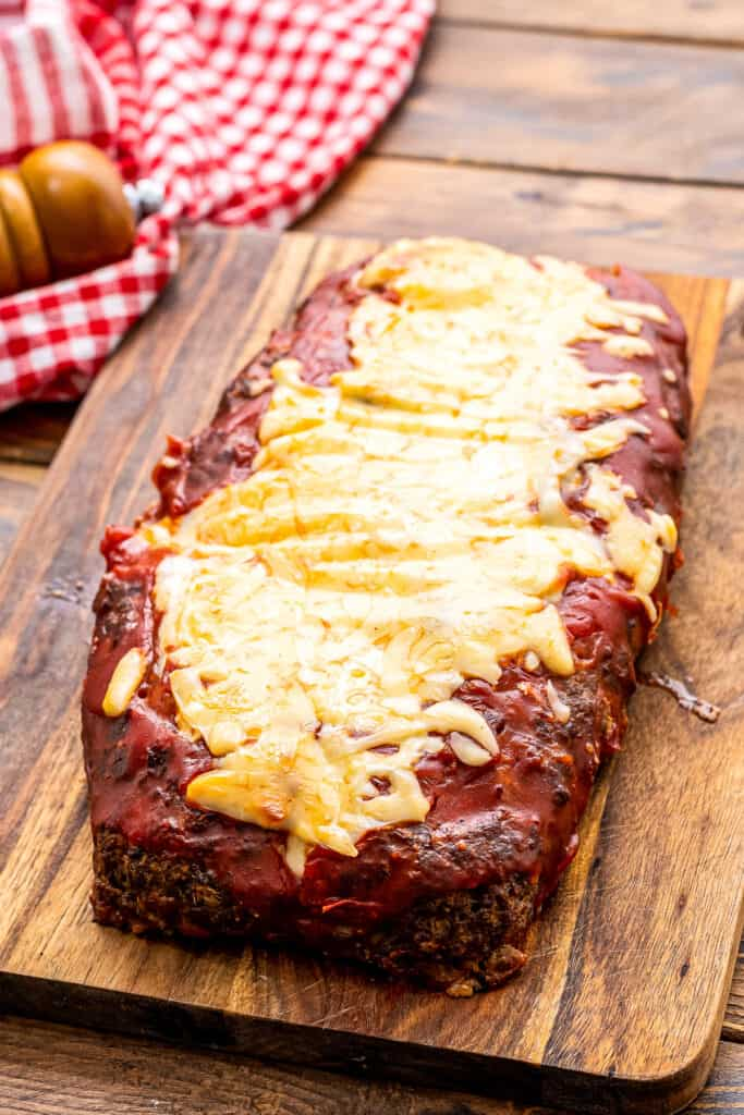 Baked Italian Meatloaf topped with tomato sauce and cheese