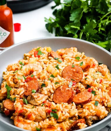 Plate of Instant Pot Jambalaya with parsley in background