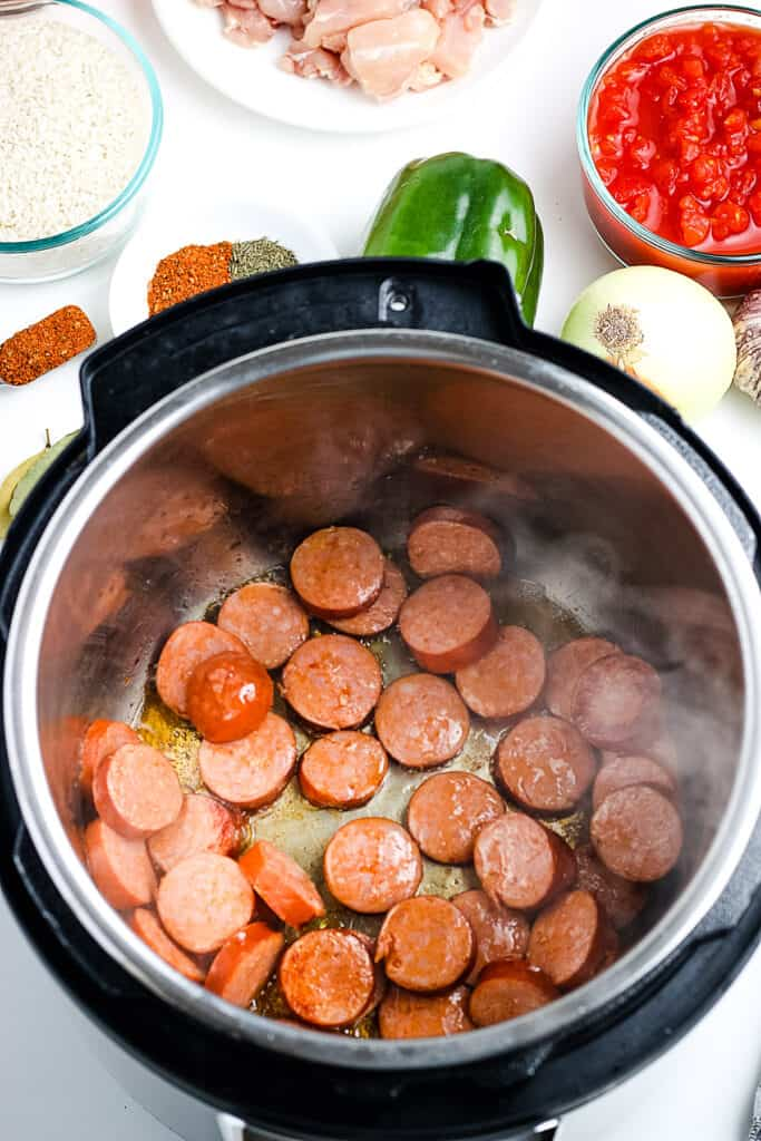 Instant Pot with sliced andouille sausage in it