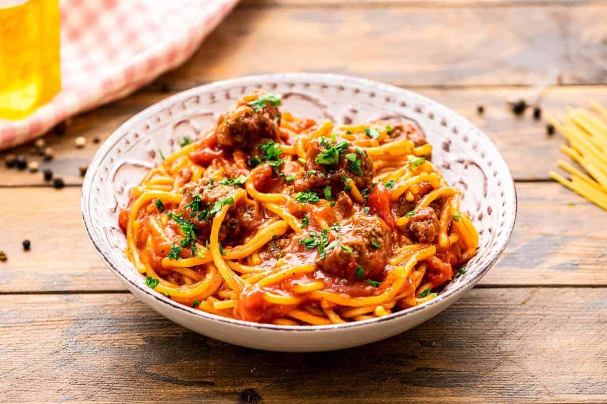 Spaghetti and Meatballs in a cream colored bowl