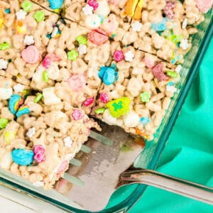 No Bake Lucky Charms Treats with spatula in pan