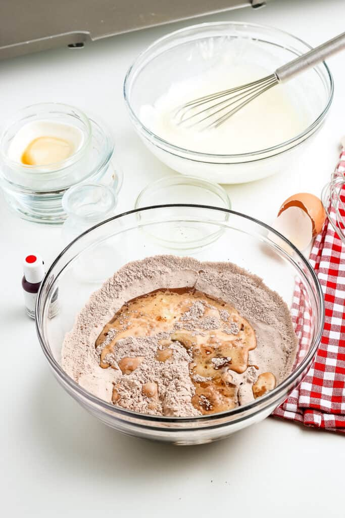 A glass bowl with dry ingredients for pancakes