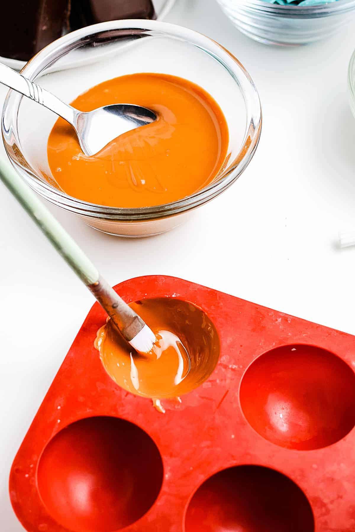 Brushing caramel into silicone molds