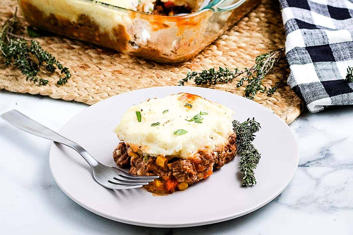 Shepherds Pie on a white plate with a fork